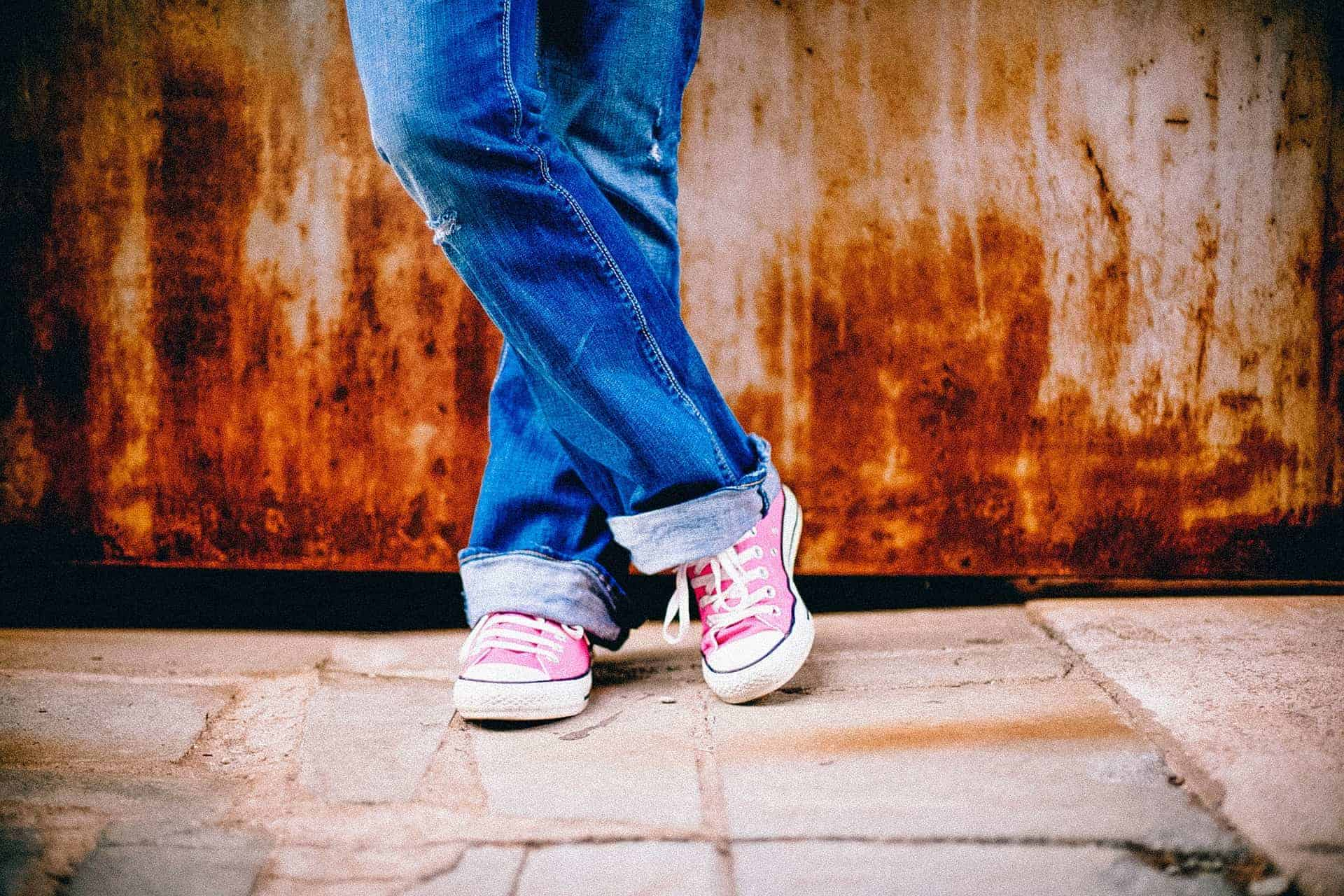 child wearing pink chucks in jeans | kimschob.com