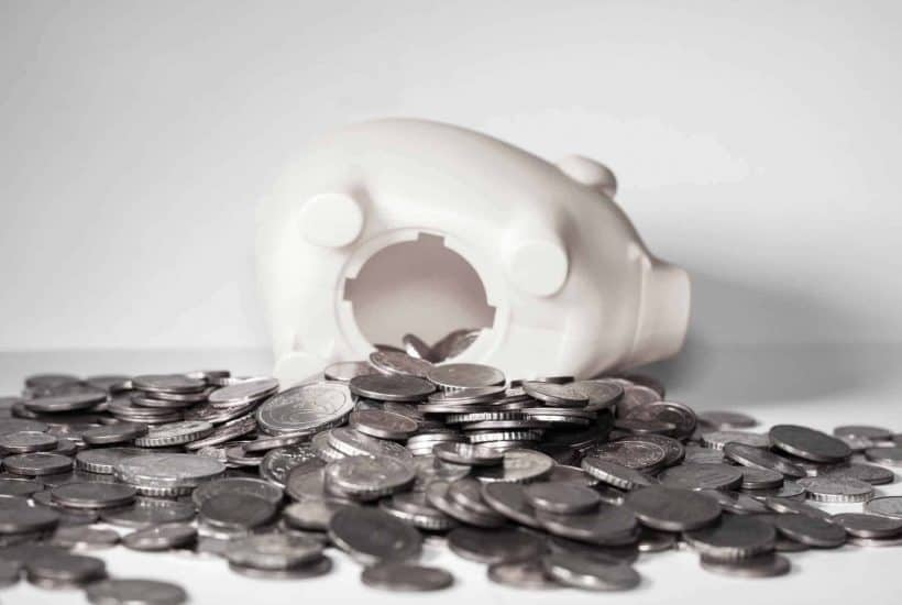 piggy bank spilled over with coins | kimschob.com