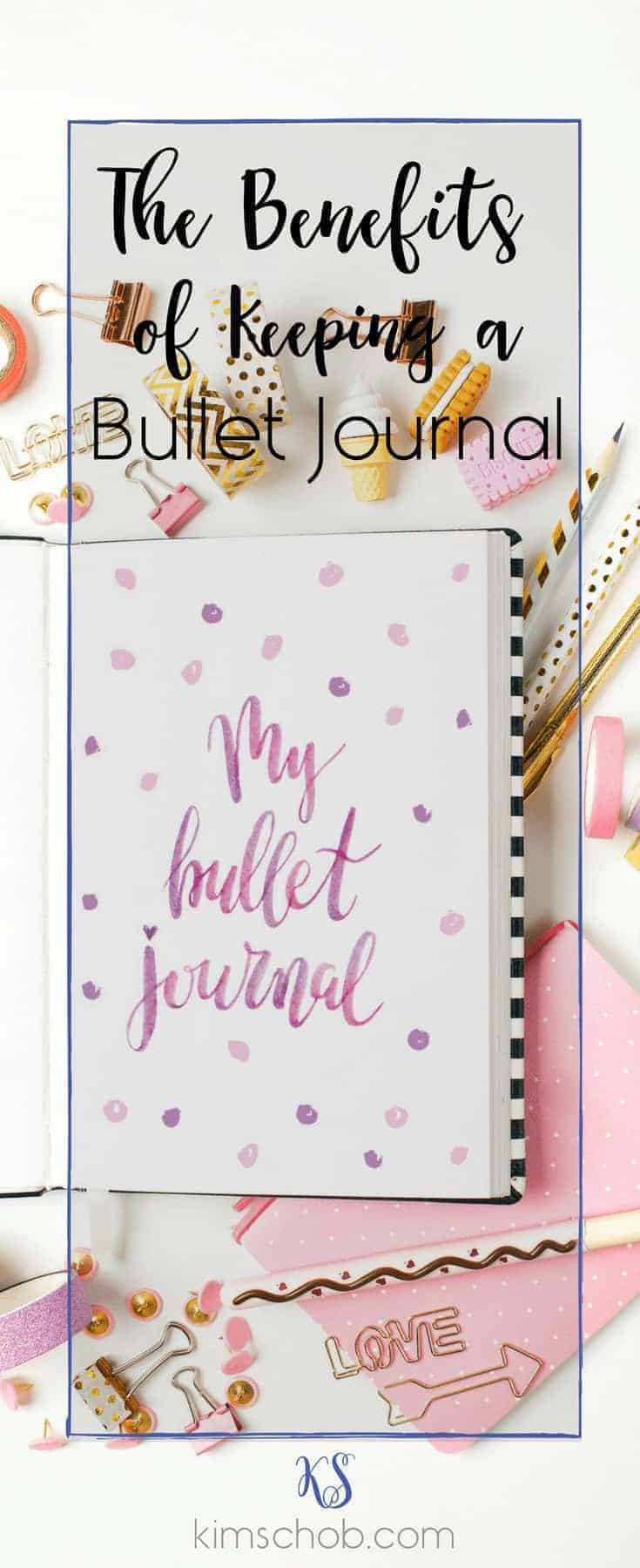 The Benefits of Keeping a Bullet Journal |bullet journal with clips, pens, and other accessories in a soft pink hue #bulletjournal #organization #lifestyle | kimschob.com