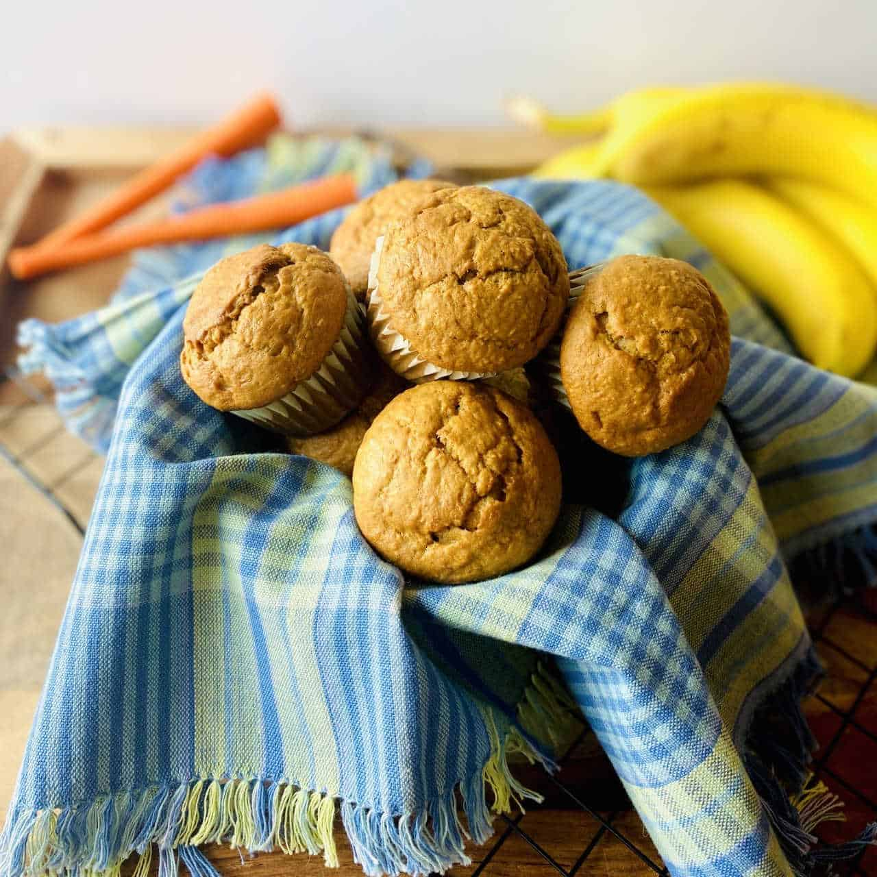 banana carrot muffins in basket with carrot and banana in background 2 1